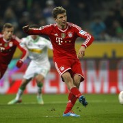 Bayern Munich's Mueller scores a penalty against Borussia Moenchengladbach during the German first division Bundesliga match in Moenchengladbach