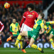 MANCHESTER, ENGLAND - DECEMBER 19: Marouane Fellaini of Manchester United and Ryan Bennett of Norwich City compete for the ball during the Barclays Premier League match between Manchester United and Norwich City at Old Trafford on December 19, 2015 in Manchester, England.  (Photo by Clive Brunskill/Getty Images)