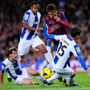 BARCELONA, SPAIN - NOVEMBER 01:  Neymar of FC Barcelona duels for the ball with Hector Moreno of RCD Espanyol during the La Liga match between FC Barcelona and RCD Espanyol at Camp Nou on November 1, 2013 in Barcelona, Spain.  (Photo by David Ramos/Getty Images)